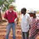 Agriculture specialist talking with officer and farmer in Zimbabwe